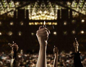 https://mediaproxy.tvtropes.org/width/350/https://static.tvtropes.org/pmwiki/pub/images/lighter_at_concert.jpg